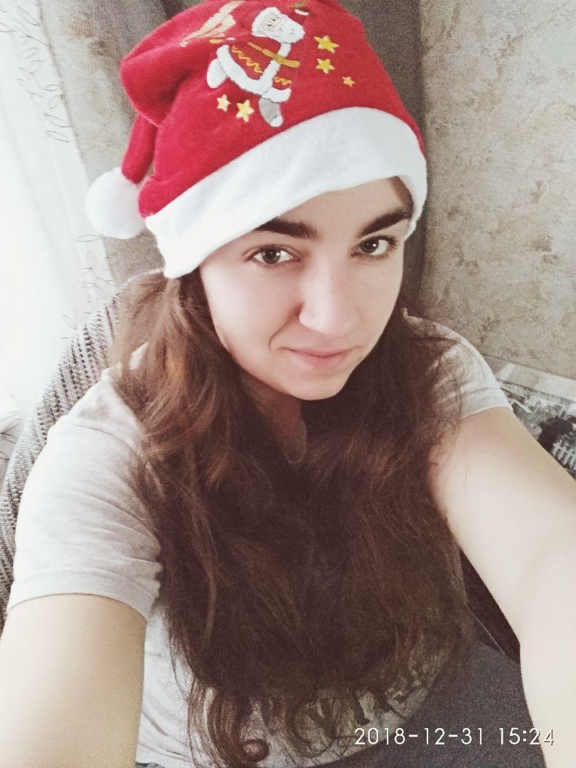 Олька Белова